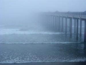 Ocean pier in the mist